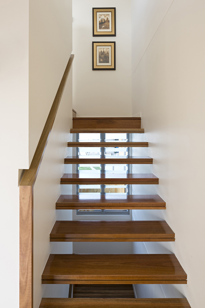 Stairway features natural wood floating steps, for light and visuals straight through.