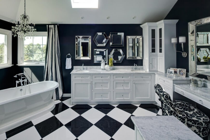 Striking blue and white primary bathroom by Drury Design