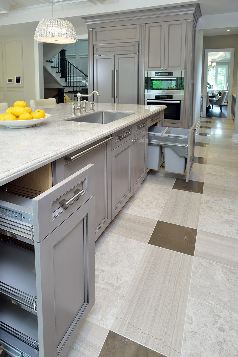 The island's large size allows for myriad storage and utility options, with built-in sink and deep slide out cabinetry.