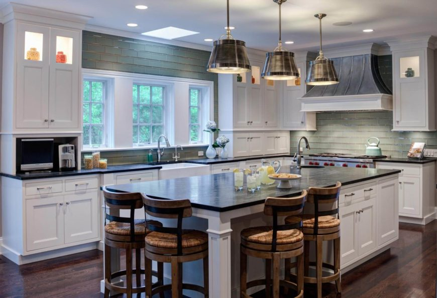 High contrast contemporary kitchen features a mixture of tones, including rich dark hardwood flooring, white cabinetry, green tile backsplash, and dark countertops.
