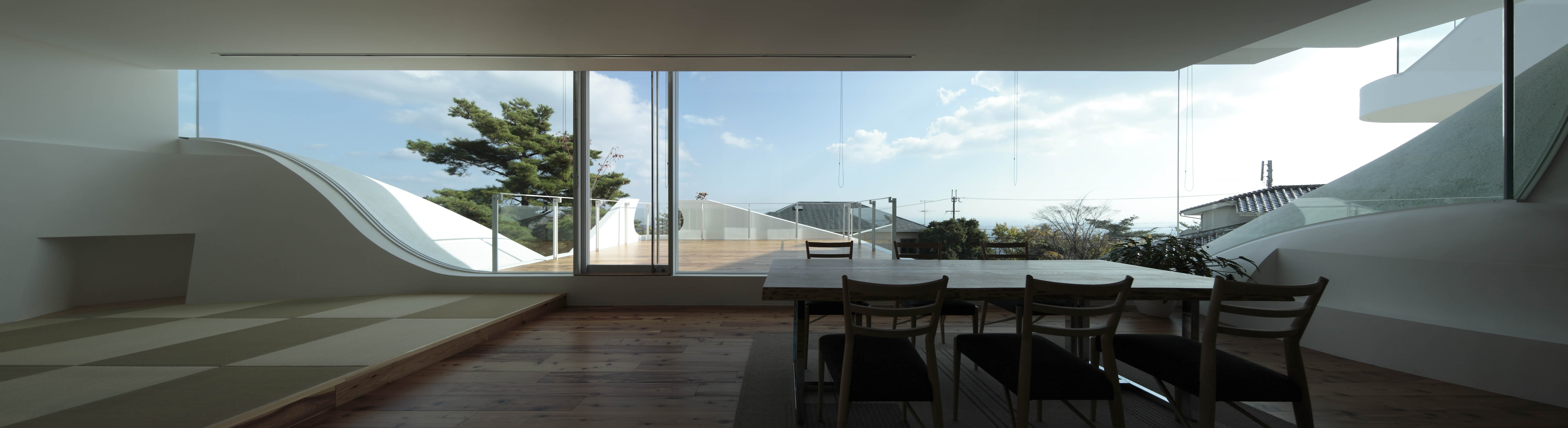 Close view of the dining area, highlighting the views afforded from nearly any space within the home.