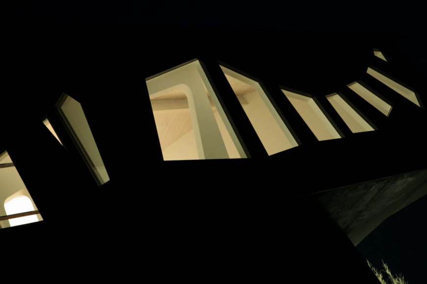 At night, the interior lighting casts a unique frame to the outside world. The butterfly inspired windows stand out in particular.