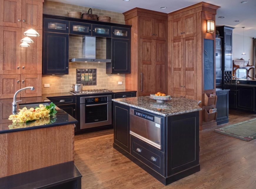 Lush natural hardwood flooring and full height cabinetry surround black stained cupboards and island in this open kitchen. Intricate tile backsplash and lighting options add distinctive highlights.