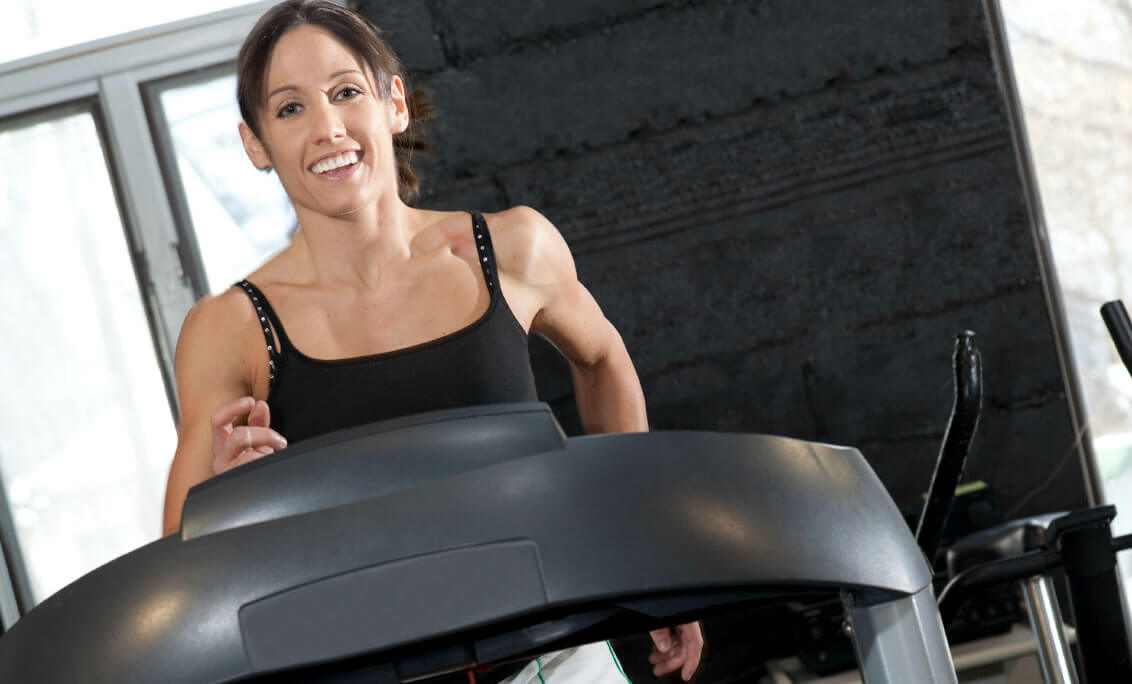 Woman running on a treadmill costing less than $1,000