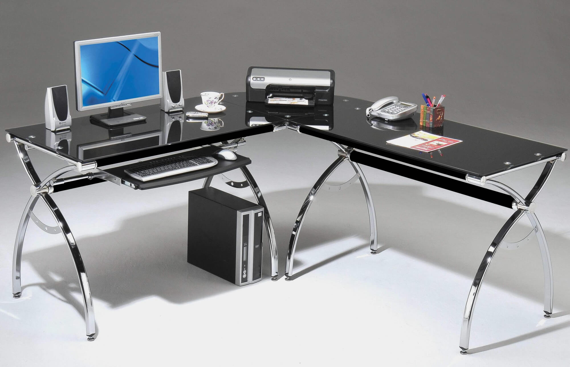 In a modern home office setting, computer desks are the most practical and utilitarian of all home office desks. These provide plenty of space for both a computer tower and monitor, as well as storage for any computer accessories, cables, and peripherals you may need. Like the writing desk, this is built for efficiency and simplicity, but with added space for hardware components.