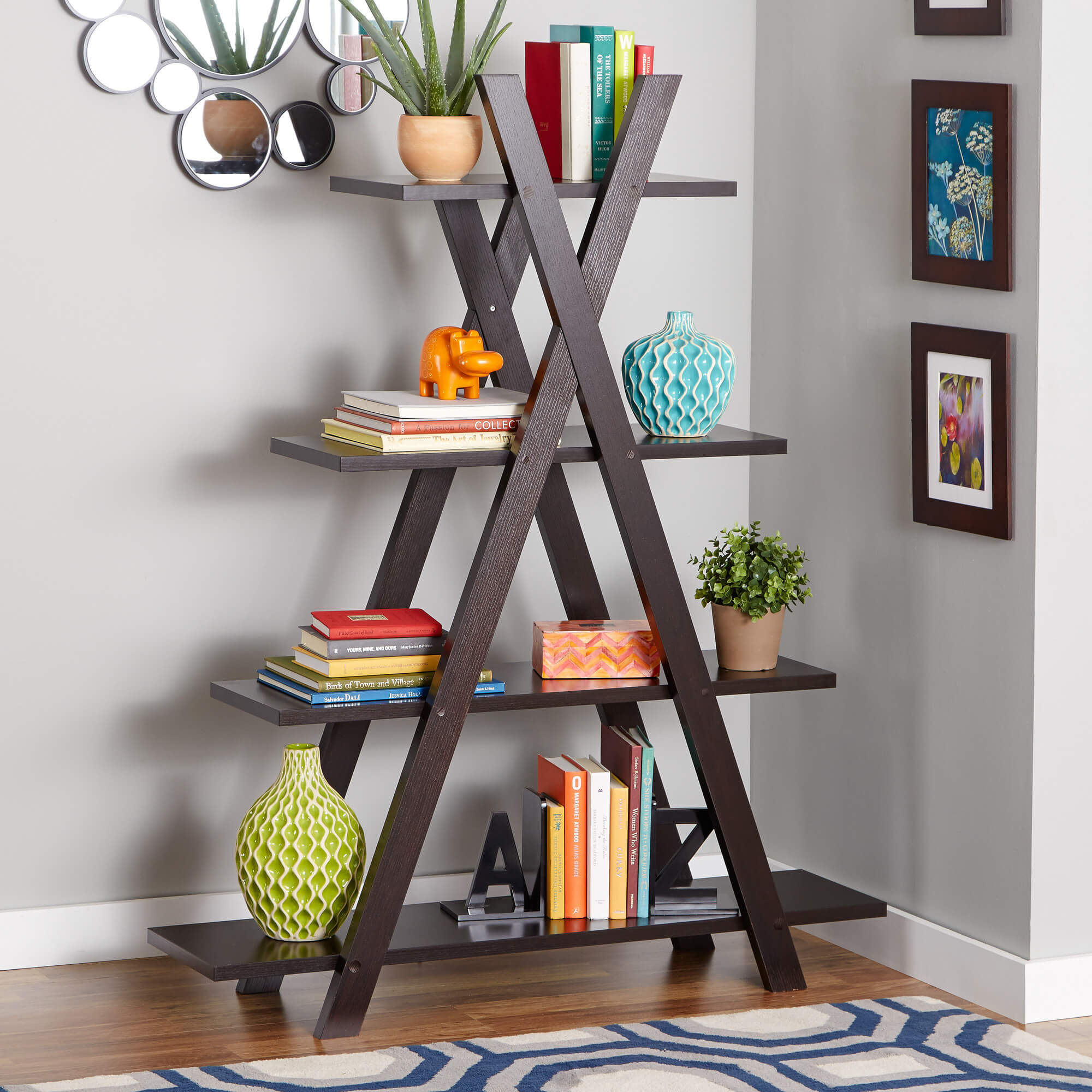 Contemporary design is not limited to any specific look or philosophy; it merely needs to be fresh, novel, and of-the-moment. These bookshelves will flaunt the newest design turns and evoke an experimental or progressive tone. Our example here features a freestanding ladder design, with an A-frame supporting ever-wider shelving.