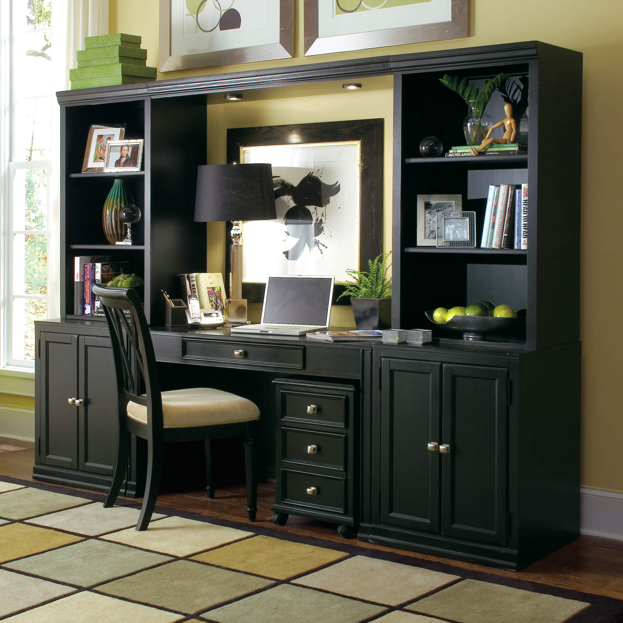 Credenza desks, as the name implies, combine a desk with a cupboard-packed credenza. This is a piece of furniture normally reserved for dining or living rooms, valued for its fashion and utility. When combined with a desk, you gain the benefits of both pieces of furniture, so long as you have the space to hold one.