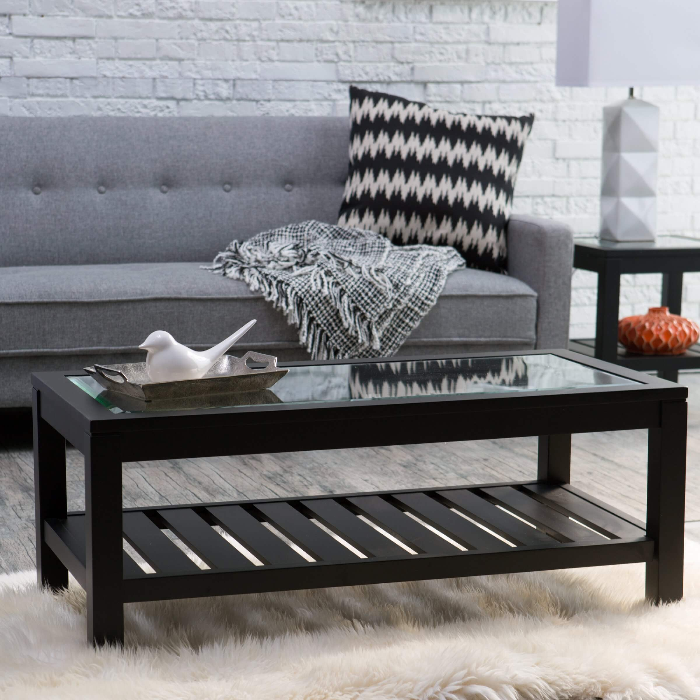 Glass top tables are incredibly popular for a reason: they add visual space, a luxurious sheen, and are stain and water damage proof. Whether metal, wood, or other construction, a glass top adds a sparkle to any table.