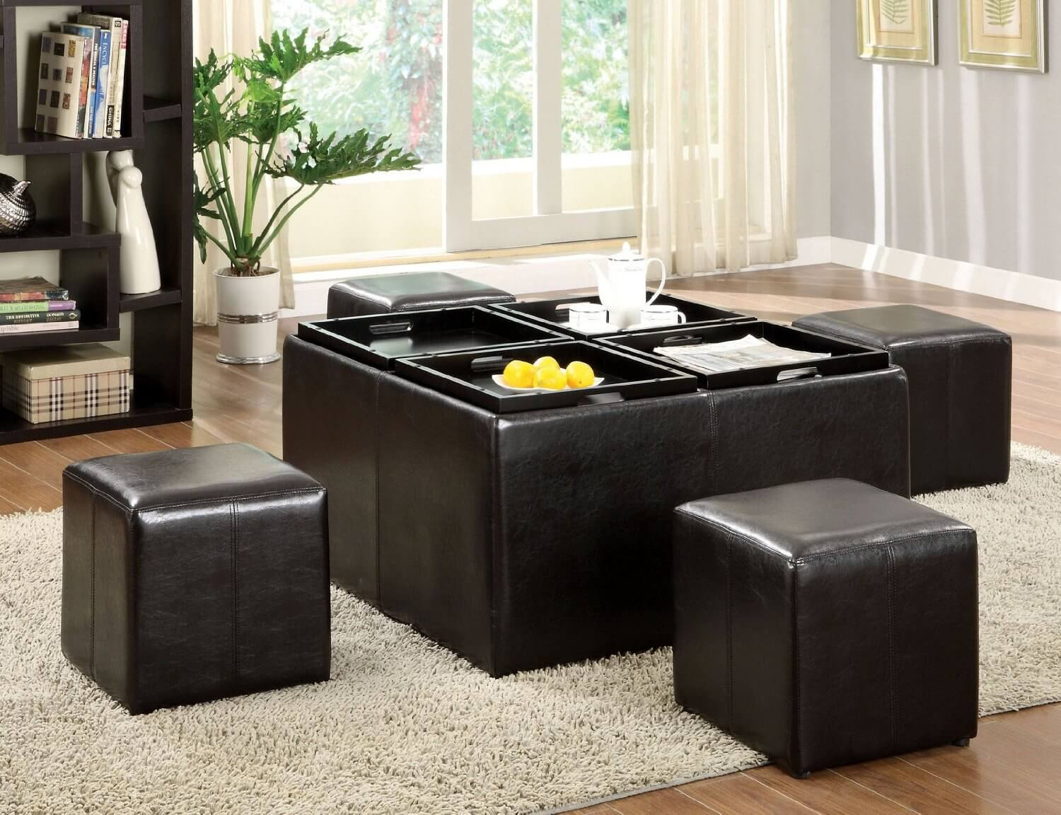 Nested ottomans combine many useful aspects of several designs, including storage capacity, reconfigurability, and versatility of placement. Models like the one pictured here allow for a large amount of storage, tablet dining, and an array of separate pieces for feet or for seating.