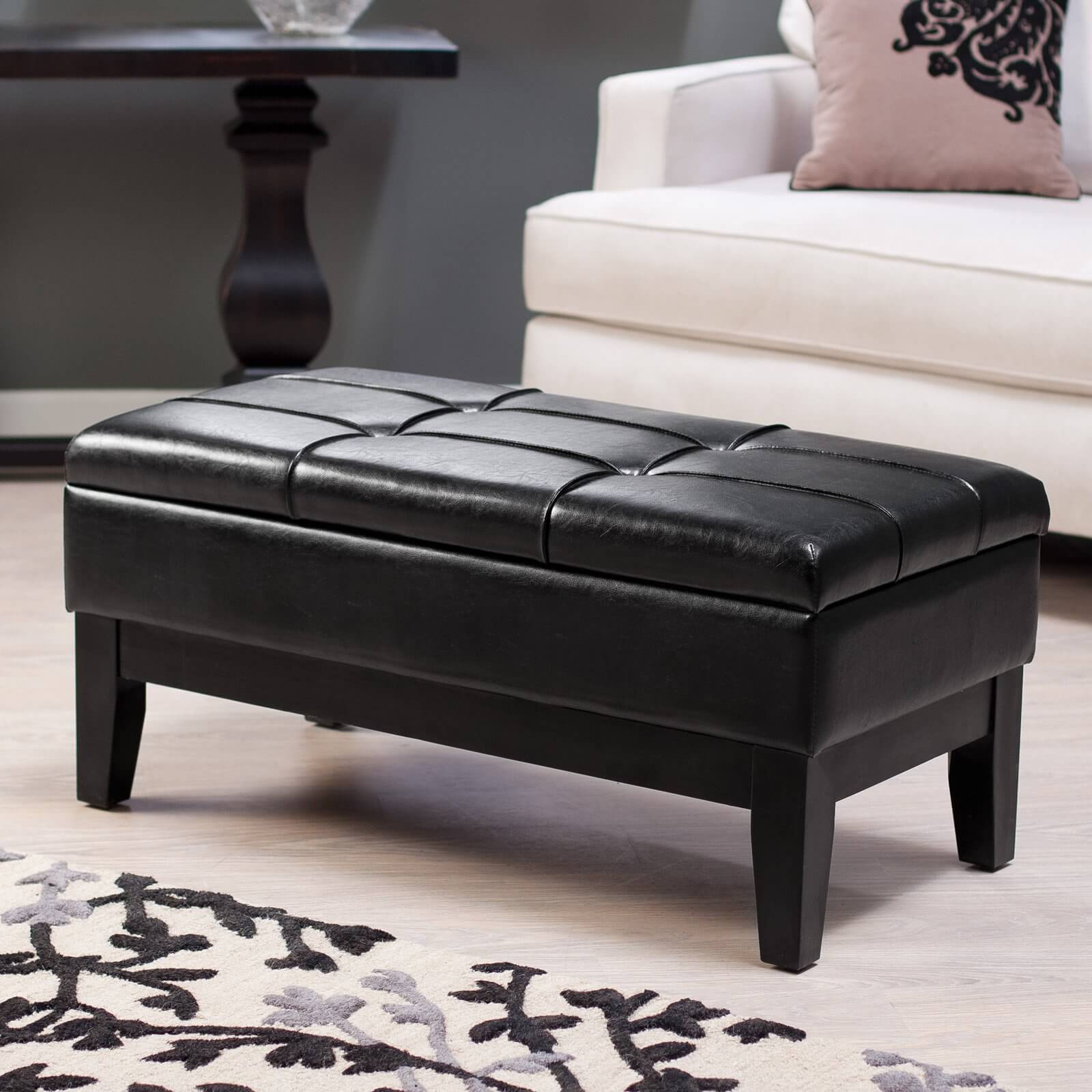 The rectangular shape allows for wider surface area, multiple spaces for feet to rest, and often, more storage options within an ottoman. These can be found in standard cushion top or cocktail style.