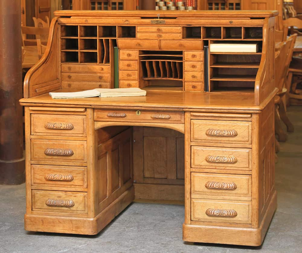 Photo of a large roll-top desk.