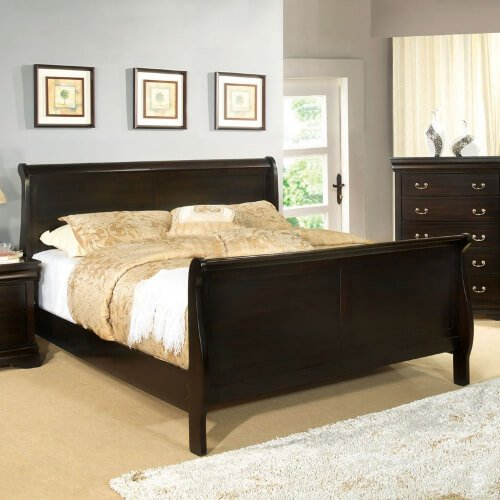 The sleigh bed features curved or scrolled foot and headboards, resembling a sled or sleigh. Often made of heavy wood, this style is a result of the French and American Empire period of the early 19th century.
