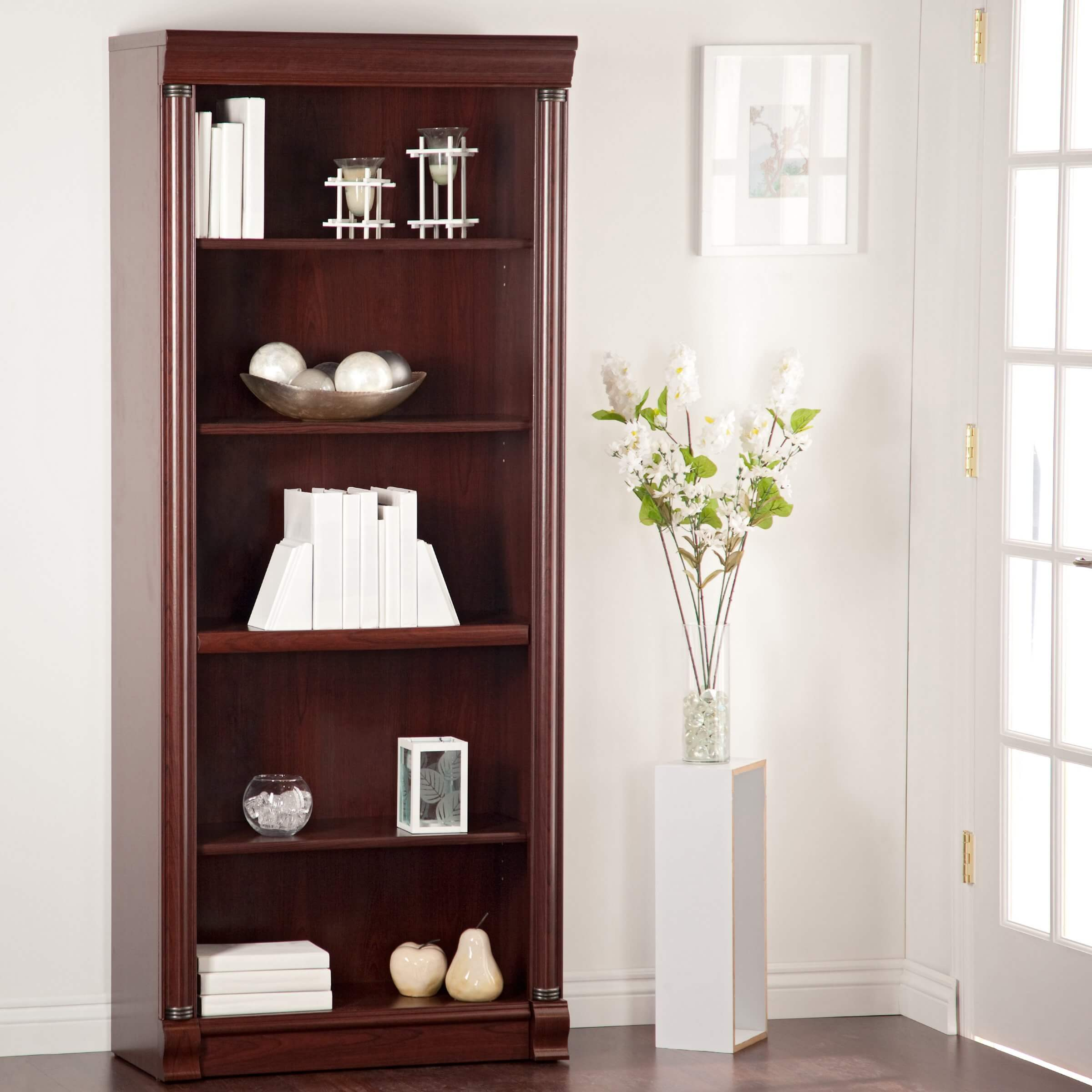 Standard design bookcases will be a large, single piece of furniture with an array of horizontal shelving, support walls, and a backing wall. They are often rectangular and tall, although not in all cases. The most common construction material is wood, but you may find them in every material available.