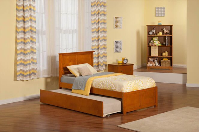 Trundle beds are usually considered a pair of beds, with one standard and a second on casters so that it may be stored beneath the upper bed. This design is a space-saving idea and allows for an extra bed to be available when necessary, without wasting space when it is not.