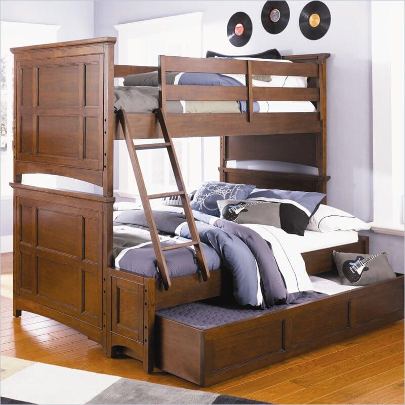 A standard trundle bed tucks a secondary bed below the main one, usually on casters, so that it can be tucked away hidden when not in use. When combined with a bunk bed, this creates a piece of furniture that can comfortably sleep three people.