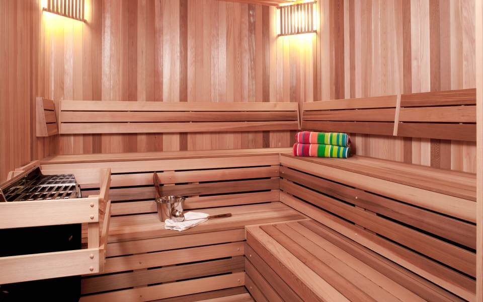 The home sports a full all-wood sauna room, with light toned paneling matching the rest of the lower level space.