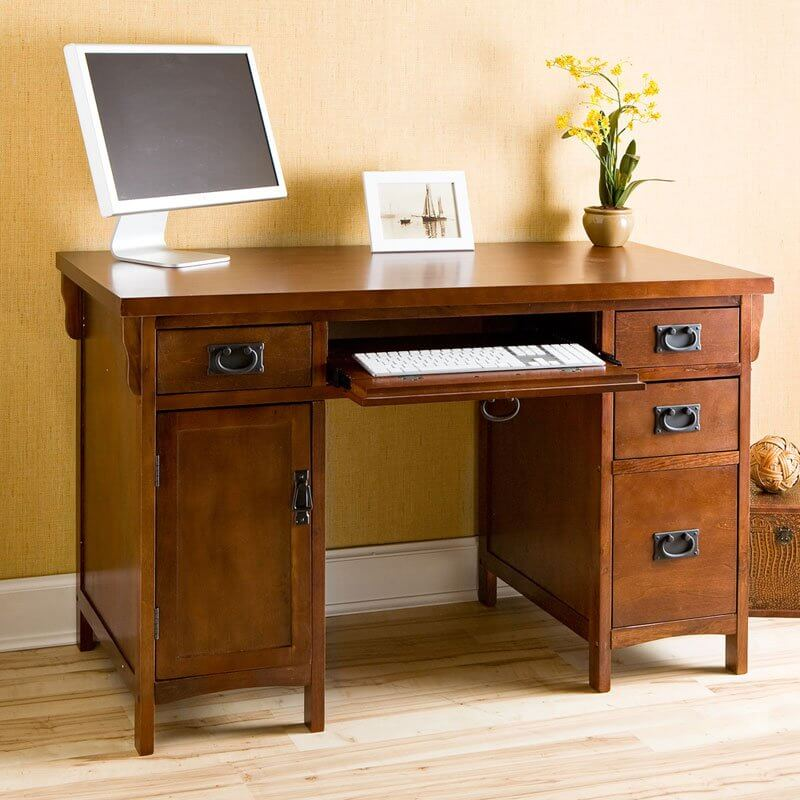 The natural wood tone, whether stained lighter or darker, is by far the most common desk finish available. With a classic look that conveys timelessness, it's no wonder these have remained popular to this day.