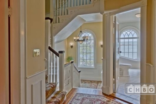 The view from the second floor landing shows a bathroom directly off the stairs and the staircase continuing up the the third floor.