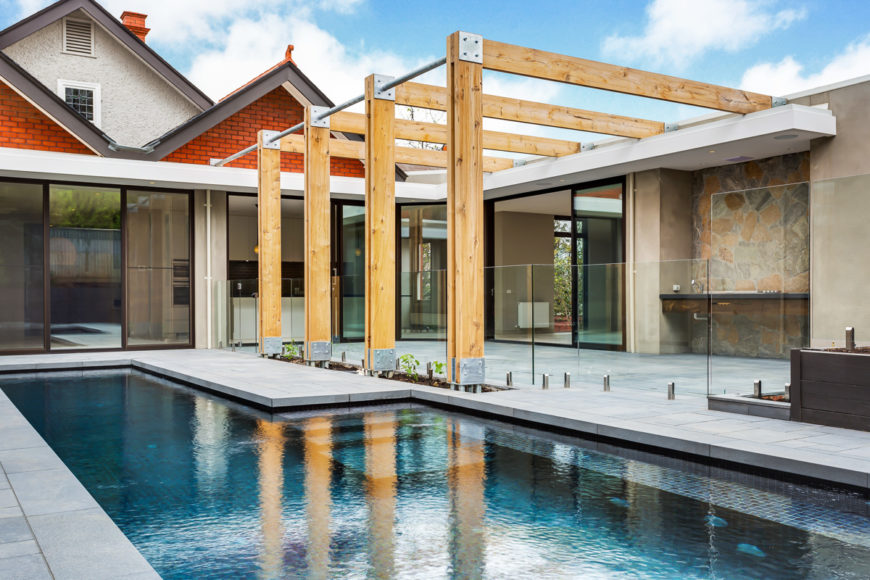 Contemporary home renovation with pool and patio courtyard by Canny Contemporary Architects