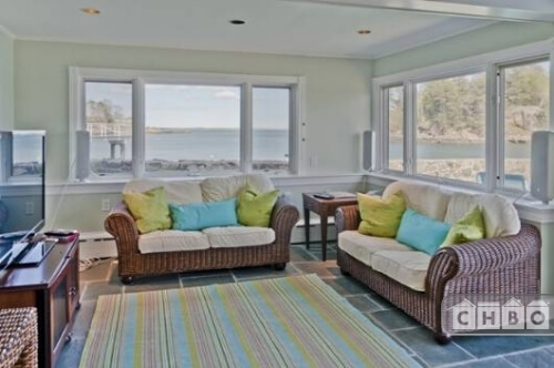 A third, more casual living room has a large television and two comfy couches from which to watch it. The large window sets each have a spectacular view.