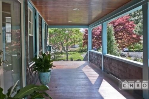 The wide front porch has recessed lighting in the polished wood ceiling. There's plenty of room for a porch swing or other seating for lazy summer afternoons or company.