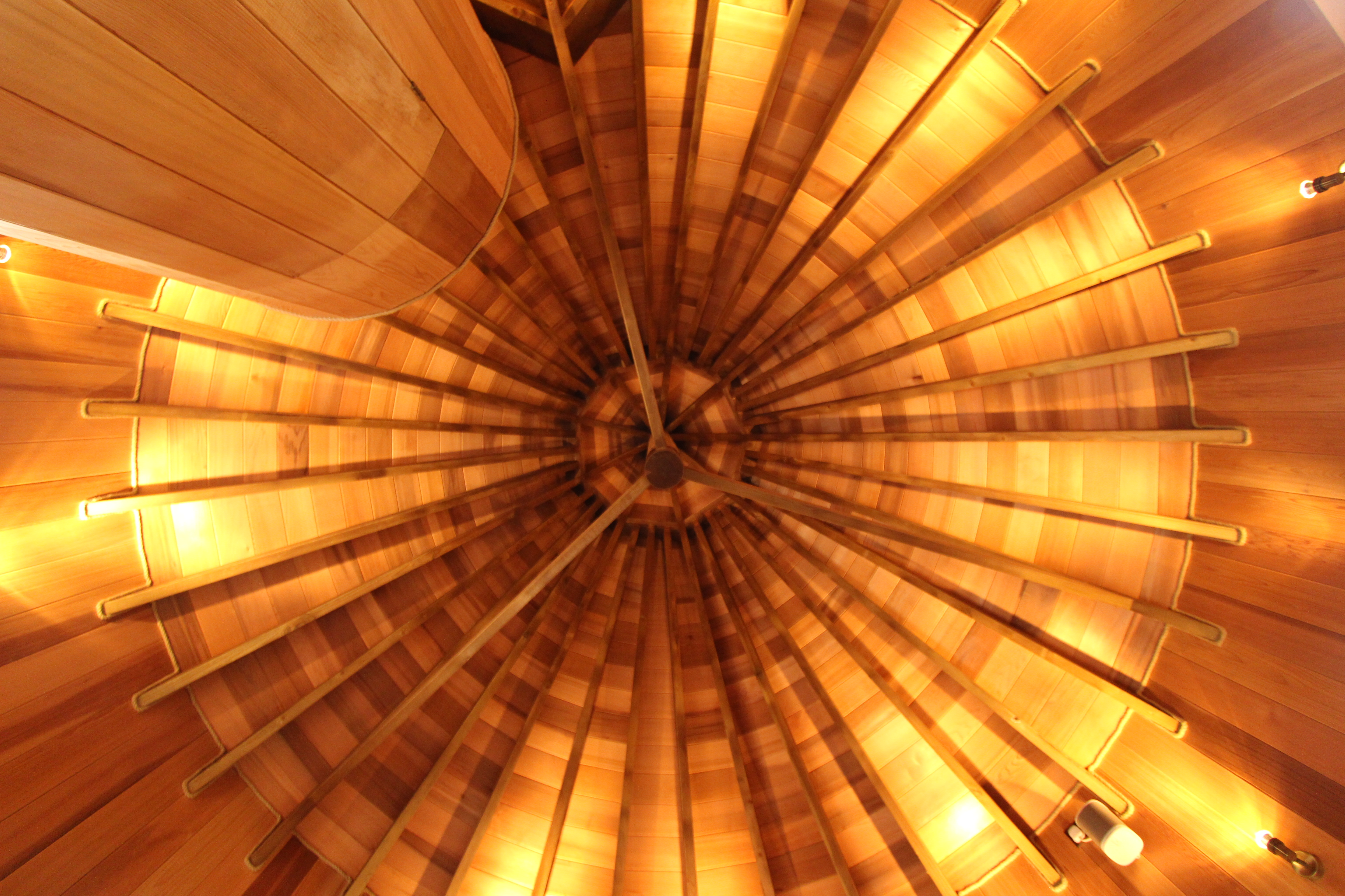 The ceilings of each turret have exposed beams and intersecting angles. From the inside, this creates space. From the outside, it gives the building its conical shape.