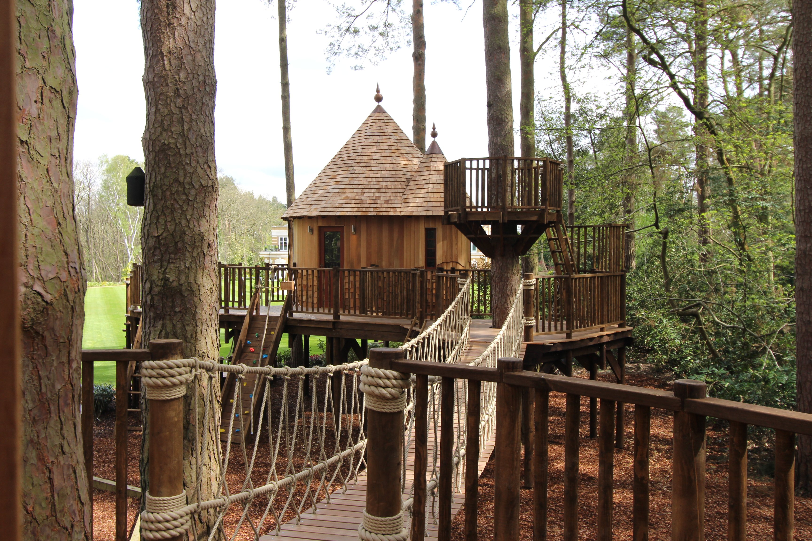 From the doorway of one treehouse, the crow's nest, climbing wall and other treehouse are clearly visible.