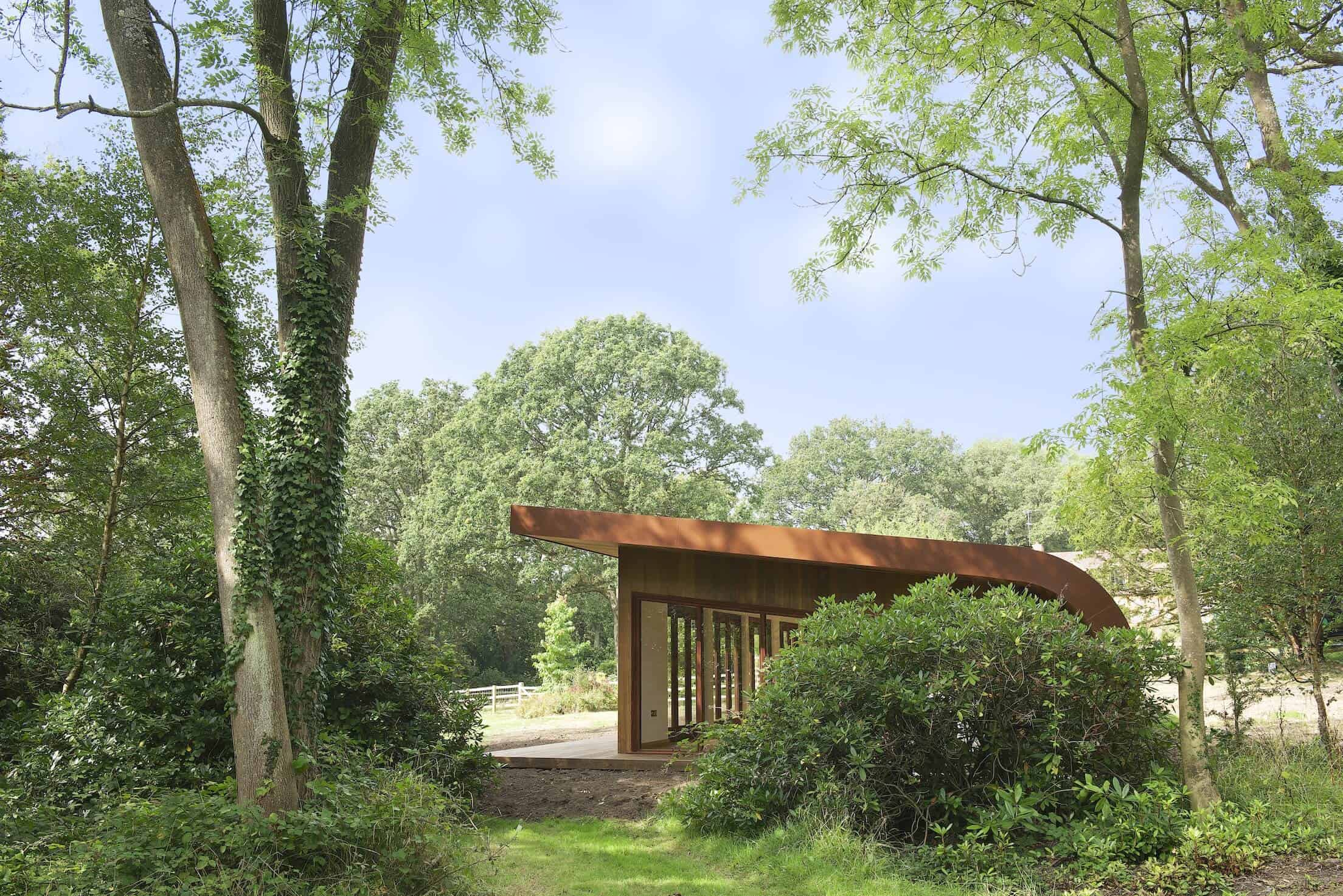 Taking in a wide view of the surrounding forest, we see how the studio meshes perfectly in its natural environment.