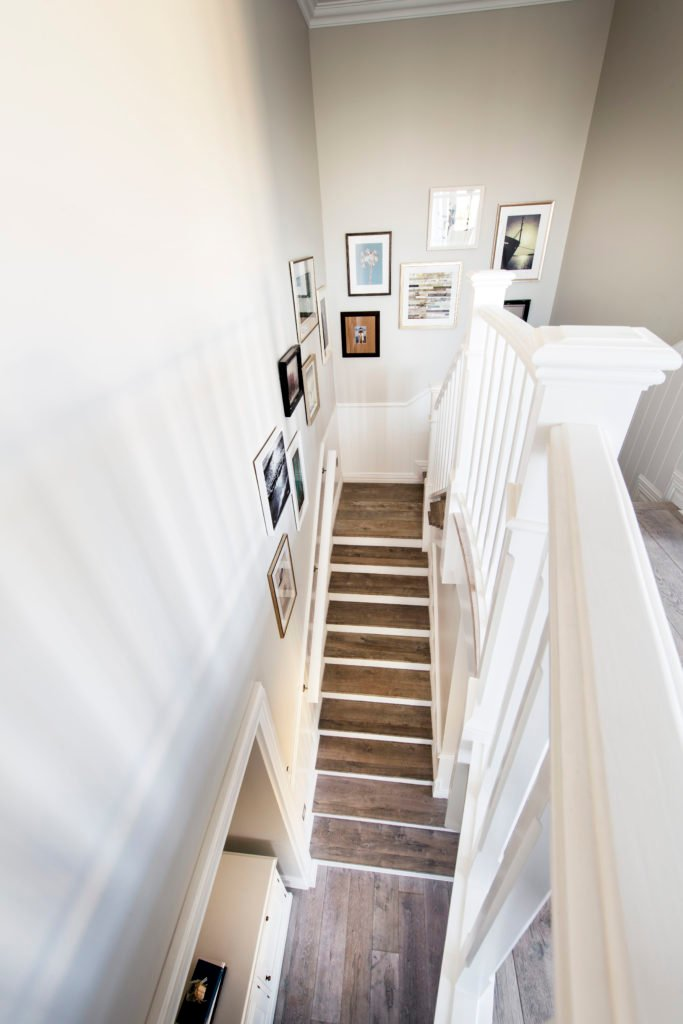 The view from the top of the stairs shows the entryway.