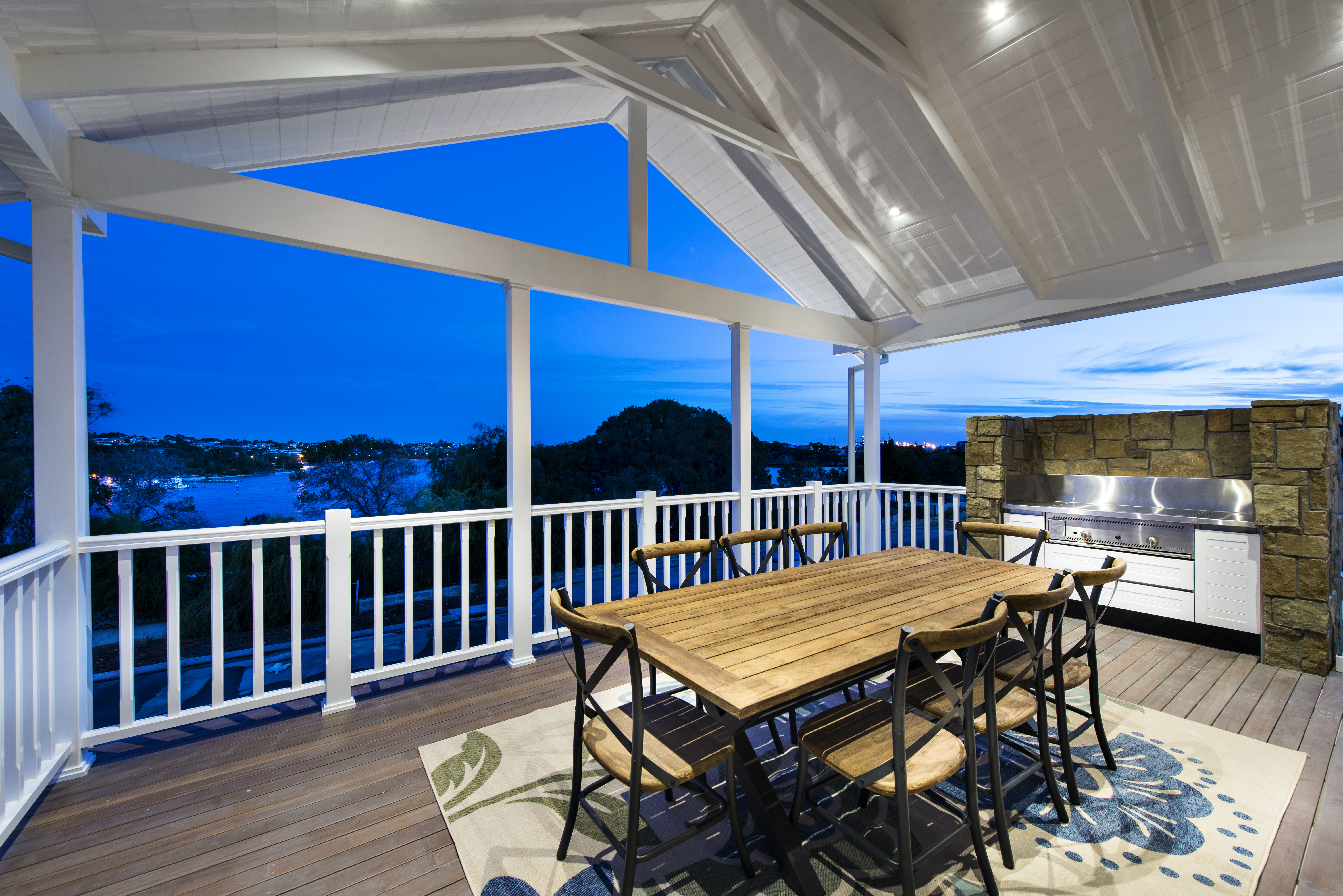 A massive outdoor grill provides another cooking area, to prevent moving through the main dining room to the kitchen and back.