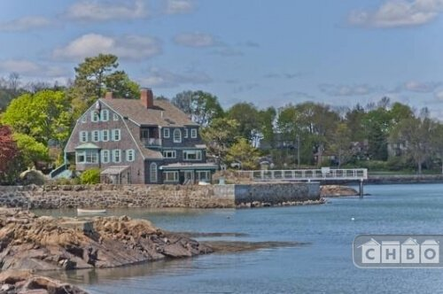 Luxury waterfront Massachusetts home with an oceanside pool