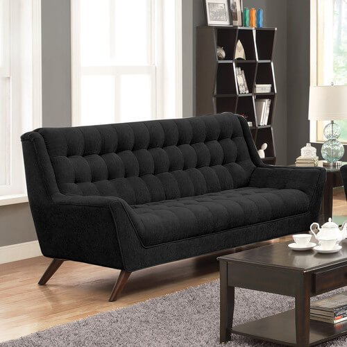 This mid-century modern black sofa has tufted seating and padded armrests. The upholstery is an attractive chenille fabric. A deep expresso finish on the wood legs adds another flair of style to the elegant sofa.