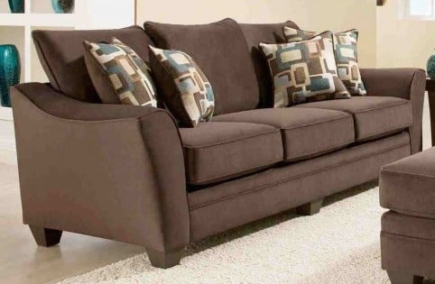 This contemporary sofa in expresso flannel includes accent pillows. The curved armrests add contemporary flair.
