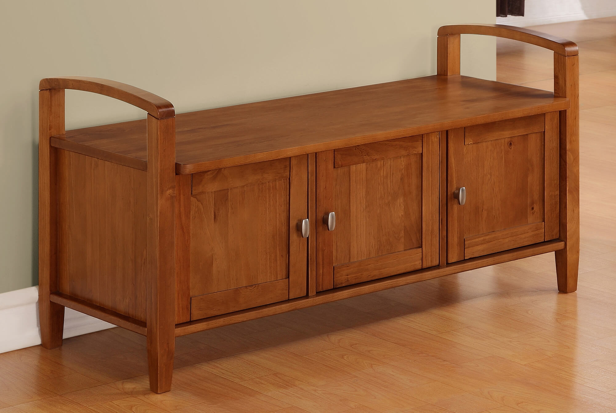 The cabinet storage bench, similar to the cubby type, features storage access on the front surface, but with cupboard doors allowing for items to be hidden away.