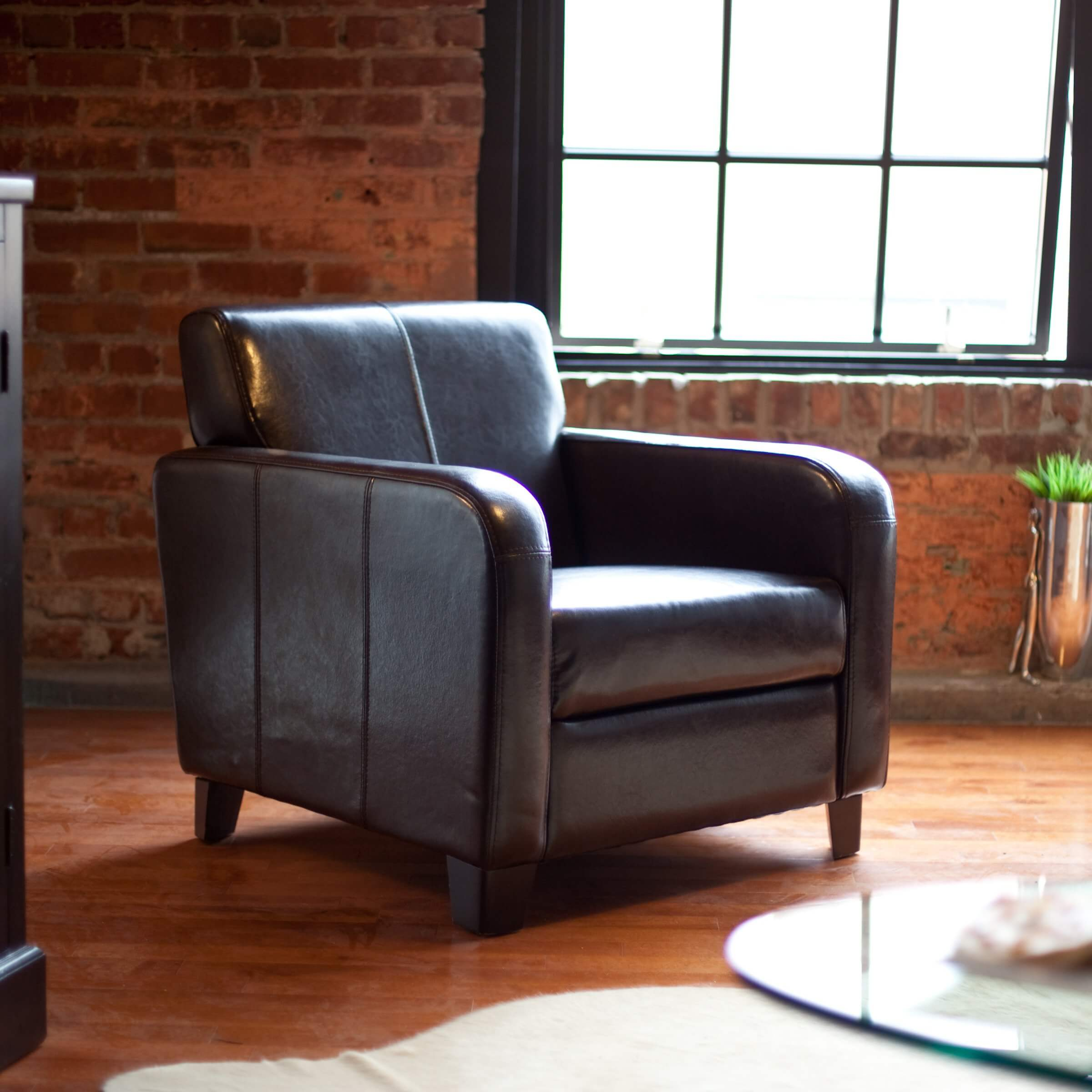 Our first club chair is a modern styled model in dark leather. The simple, clean lines of this design evoke a timeless appeal.