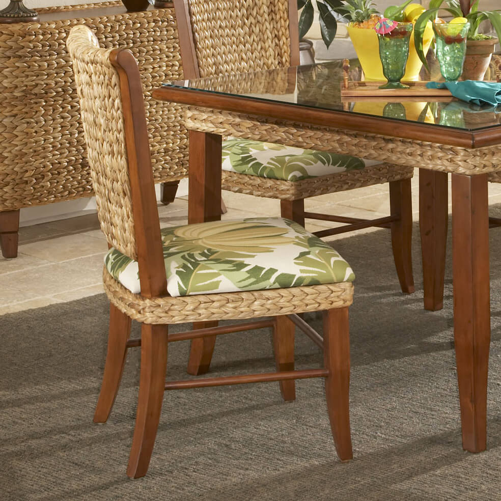 Coastal is a style, as the name implies, meant to evoke a seaside feeling. Lighter tones, unstained wood, and a relaxed air come into play with these chairs, as seen in our example below.