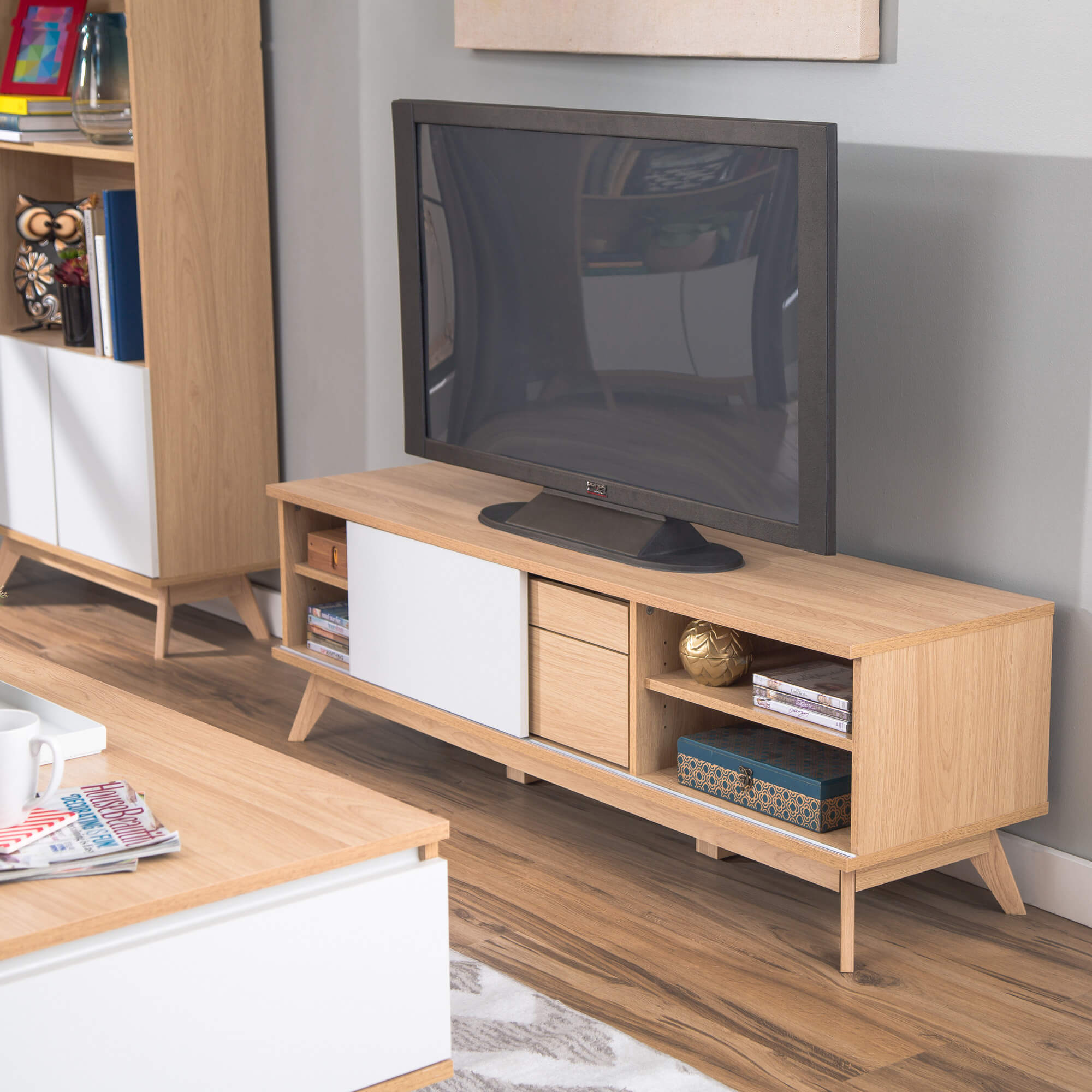 With a singular, holistic shape, the console design incorporates useful shelving and abundant surface area into a concise piece of furniture. Most models have closed shelving and a rectangular structure.