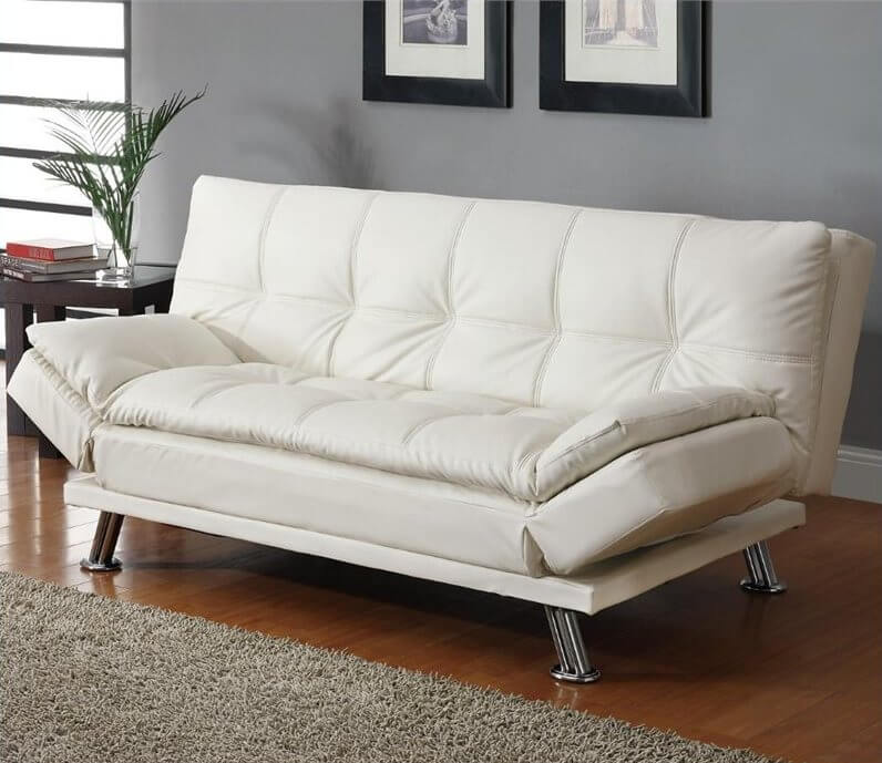 This contemporary white convertible sofa has plush pillow-top cushions to sink into and relax. The extra comfort comes in handy, as this sofa doubles as a futon when the backrest and armrests are folded down.