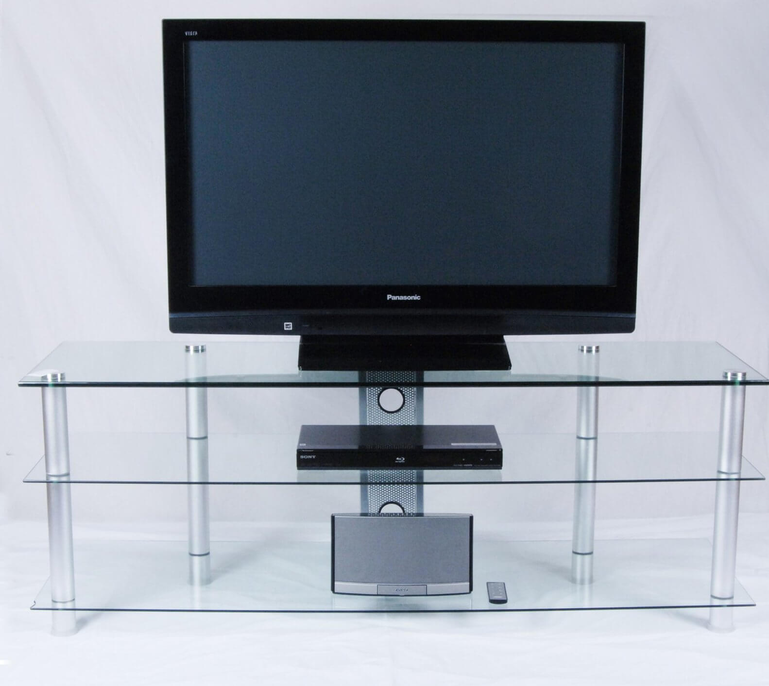 Glass models imbue the entertainment space with a boldly progressive appearance, opening the visual space and revealing the electronics in discreet beauty. Usually fitted together with metal support pieces, glass TV stands are perfect for those who value a clutter-free space.
