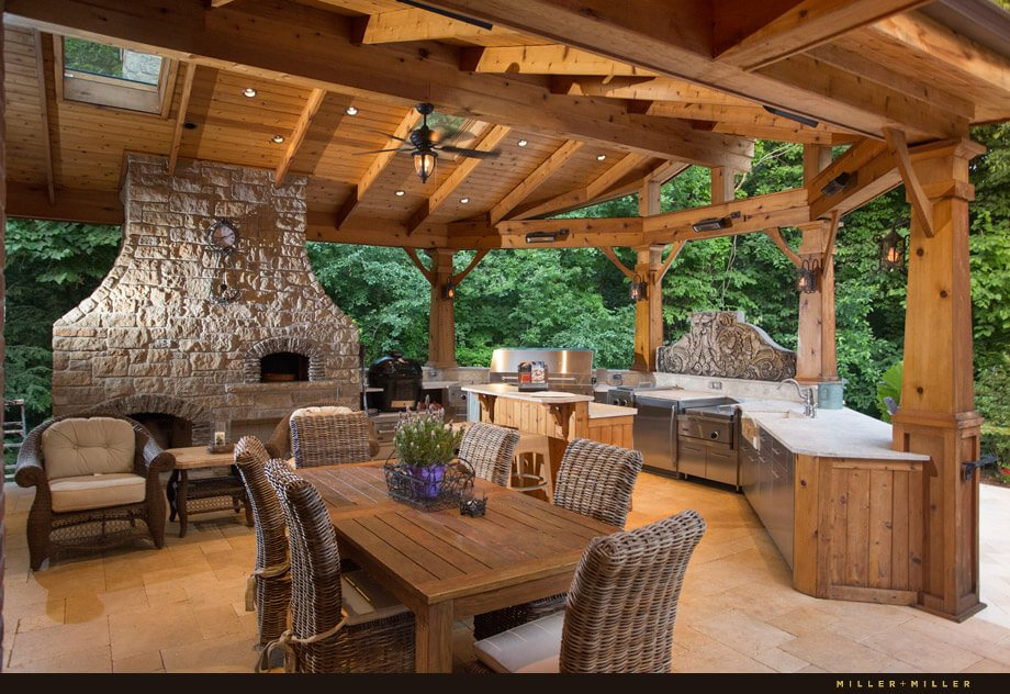 The entire cooking and dining area is covered by a wooden roof with several skylights and recessed lighting for nighttime entertaining. Additionally, there is a ceiling fan to circulate air on a hot, still day.