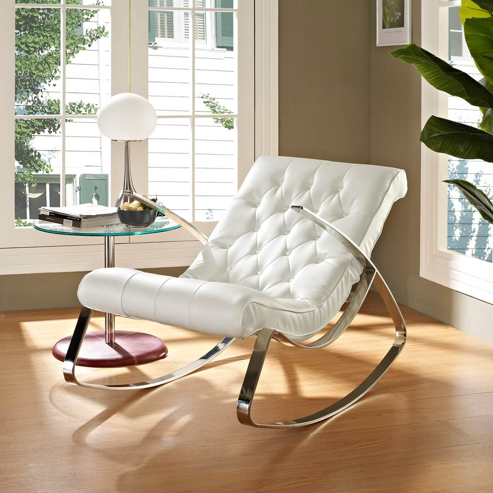 Breaking free from the standard rocking chair design, we bring you a thoroughly modern example. This piece stands a white tufted leather seat over chromed metal frame, in a reclined shape.