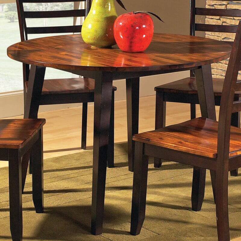 Round tables allow for shifting seating options, and often hold features such as hinged edges or a leaf, which turns it into an oval shape.