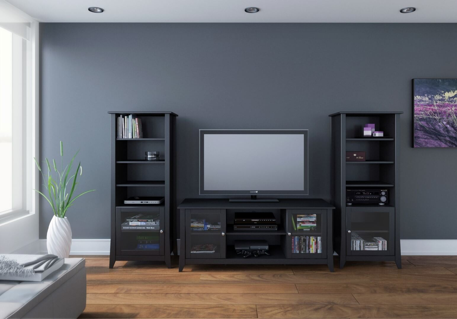 The TV stand with audio towers is a modular form that mimics most of the functionality and presentation of a full entertainment center, with a pair of tall structured shelves flanking the central stand and television itself. These allow for the placement of speakers and any other supplemental equipment.