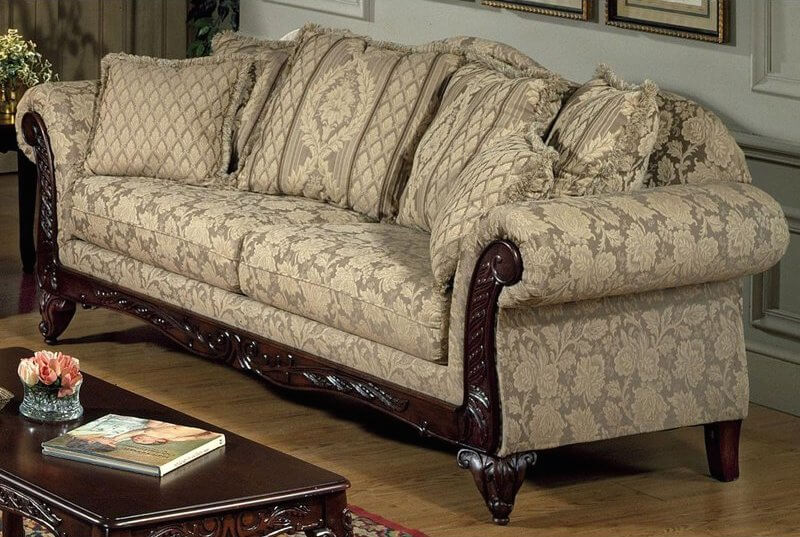This more traditional option has a solid hardwood frame with ornate, classic Victorian details. The subdued floral pattern is in a soft caramel beige. Rolled armrests are part of the traditional style.