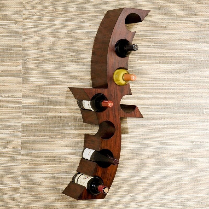 Our first example is a carved wood piece that would feel at home in any rustic or modern space.