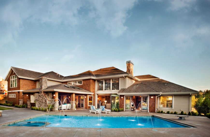 Rear exterior shot of the home and beautiful pool.