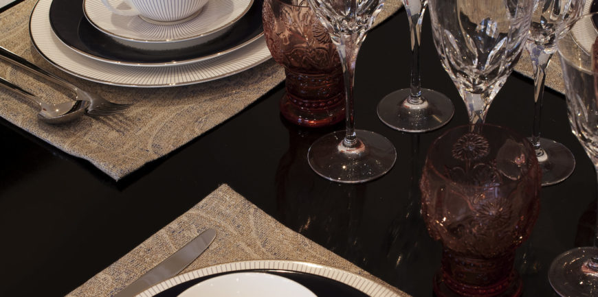The sleek, black tabletop helps highlight surrounding details, a good example of the design philosophy at play.