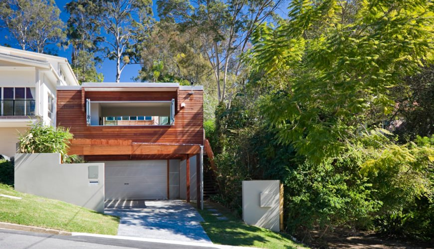 The minimalist box shape of the exterior allows for a surprising amount of innovation within and without. The timber cladding adds a natural element to the contemporary shape.