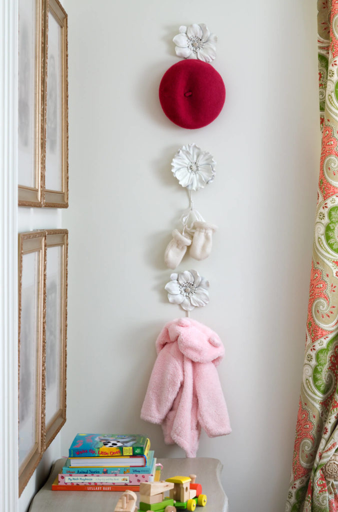 The large floral hangers are in ivory, and will be large enough to hold larger items of clothing as the little girl grows up.