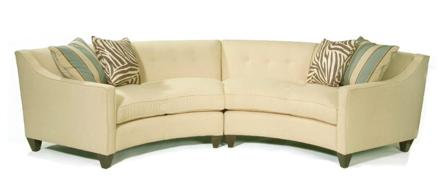 Another two-piece sectional with button tufted backing, this soft yellow sofa stands over dark natural wood arrow feet for a gently contrasting look.